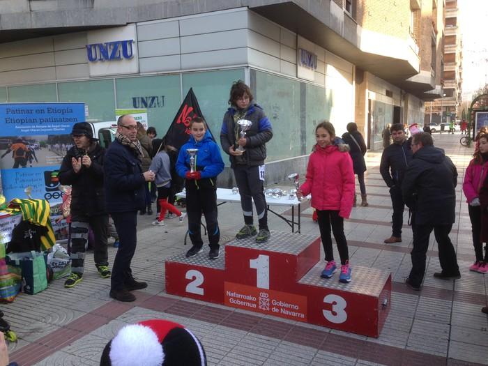Lapuente, Goikoetxea eta Ormazabal Iruñeko patinen gaineko San Silbestreko podiumean